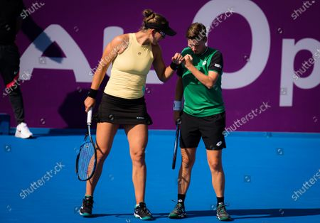 Stock Image of Nicole Melichar of the United States & Demi Schuurs of the Netherlands playing doubles at the 2021 Qatar Total Open WTA 500 tournament