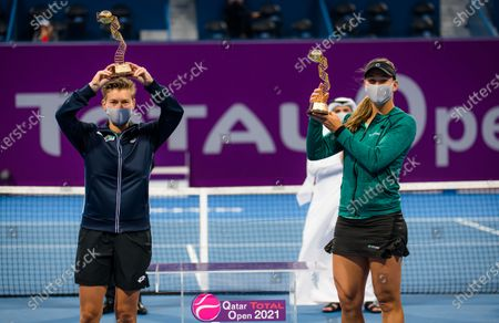 Nicole Melichar of the United States & Demi Schuurs of the Netherlands with their champions trophies doubles final of the 2021 Qatar Total Open WTA 500 tournament