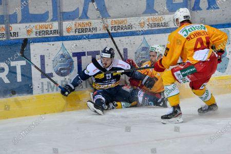 Stock Picture of #13 Marco Mueller (Ambri) against #71 Julian Schmutz (Tigers) and #40 Flavio Schmutz (Tigers)