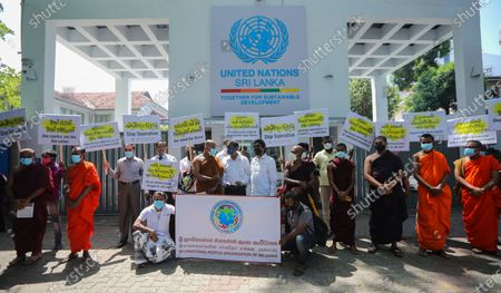 Sri Lankan Buddhist monks accompanied by laymen hold placards during a protest in front of the United Nations office in Colombo, Sri Lanka, 01 March 2021. A group of Buddhist monks and members of the 'International People's Organisation of Sri Lanka' protested the moves by the United Nations Human Rights Council (UNHRC) which is currently holding its 46th regular session in Geneva to introduce resolutions imposing sanctions on the island nation for 'war crimes and human rights violations'. The UNHRC is to introduce another resolution on Sri Lanka, based on a report by UNHRC Commissioner Michelle Bachelet, which calls for an International Criminal Court investigation into Sri Lanka's near 30-year-old separatist conflict that ended in 2009 and sanctions against top military personnel and others accused of war crimes. The Sri Lankan government has firmly denied such violations and has urged member countries to defeat this 'politically biased' resolution.
