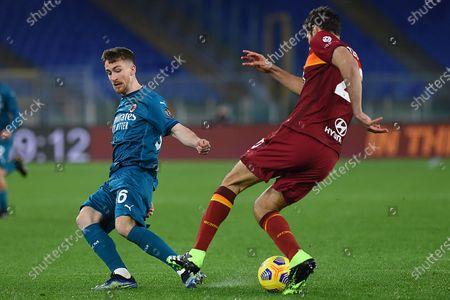 Alexis Saelemaekers of Milan Federico Fazio of Roma in action