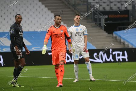 Lyon's goalkeeper Anthony Lopes faces Milik during the French League One soccer match between Marseille and Lyon at the Stade Veledrome stadium in Marseille, France, Sunday, Feb. 28, 2021.