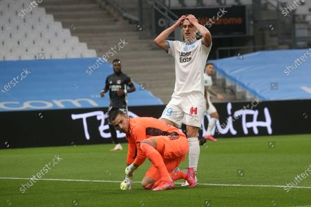 Lyon's goalkeeper Anthony Lopes makes a save during the French League One soccer match between Marseille and Lyon at the Stade Veledrome stadium in Marseille, France, Sunday, Feb. 28, 2021.