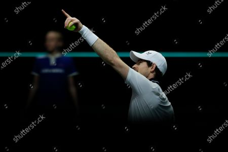 Britain's Andy Murray complains about the lighting as he warms up for his match against Netherland's Robin Haase during their first round men's singles match of the ABN AMRO world tennis tournament at Ahoy Arena in Rotterdam, Netherlands