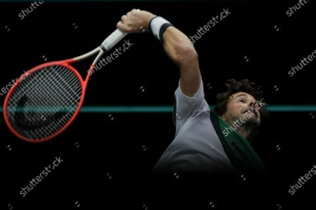 Netherland's Robin Haase serves against Britain's Andy Murray during their first round men's singles match of the ABN AMRO world tennis tournament at Ahoy Arena in Rotterdam, Netherlands