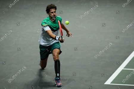 Netherland's Robin Haase plays a shot against Britain's Andy Murray during their first round men's singles match of the ABN AMRO world tennis tournament at Ahoy Arena in Rotterdam, Netherlands