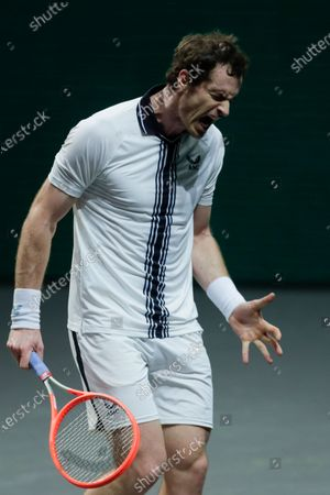 Britain's Andy Murray reacts after missing a shot against Netherland's Robin Haase during their first round men's singles match of the ABN AMRO world tennis tournament at Ahoy Arena in Rotterdam, Netherlands