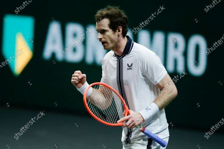 Britain's Andy Murray clenches his fist after defeating Netherland's Robin Haase in three sets 2-6, 7-6, 6-3, in their first round men's singles match of the ABN AMRO world tennis tournament at Ahoy Arena in Rotterdam, Netherlands