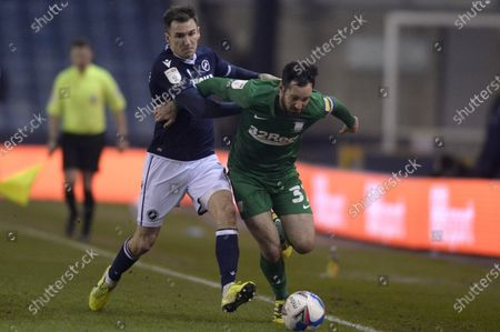 Jed Wallace of Millwall and Greg Cunningham of Preston North End in action during the Sky Bet Championship, Championship match between Millwall and Preston North End at The Den in London - 2nd March 2021