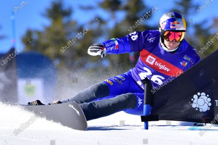 Roland Fischnaller of Italy races down the slope during the men's Parallel Giant Slalom (PGS) Qualification Run at the FIS Snowboard World Championships in Rogla, Slovenia, 01 March 2021.