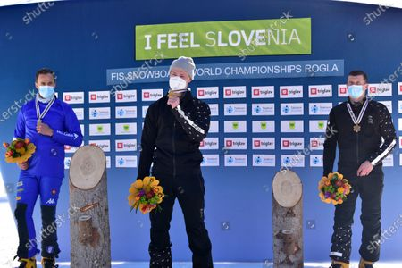 (L-R) Silver medalist Roland Fischnaller of Italy, gold medalist Dmitry Loginov of Russia  and bronze medalist Andrey Sobolev of Russia react during the award ceremony of the men's Parallel Giant Slalom (PGS) race at the FIS Snowboard World Championships in Rogla, Slovenia, 01 March 2021.