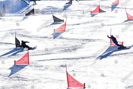 Dmitry Loginov (L) of Russia and Roland Fischnaller of Italy clear gates in the Big Final of men's Parallel Giant Slalom (PGS) race at the FIS Snowboard World Championships in Rogla, Slovenia, 01 March 2021.