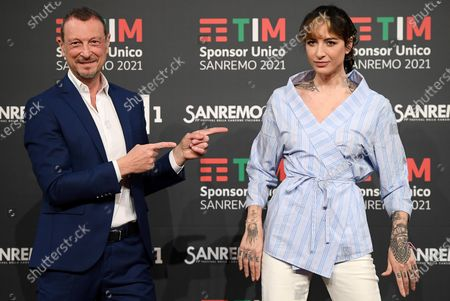 Sanremo Festival host and artistic director, Amadeus and Rai Radio2 Dj Ema Stokholma (R) pose during a photocall on occasion of the 71st Sanremo Italian Song Festival, in Sanremo, Italy, 01 March 2021. The music festival runs from 02 to 06 March.