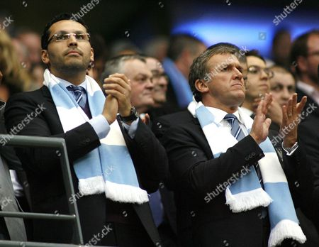 Manchester City chairman Khaldoon Al Mubarak and chief executive Garry Cook applaud the teams