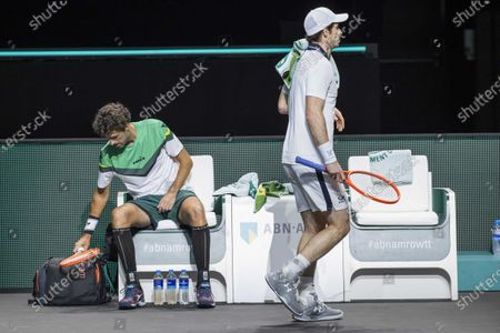 Robin Haase (L) of the Netherlands inbetween games against Andy Murray (R) of Britain during their first round match at the ABN AMRO World Tennis Tournament in Rotterdam, the Netherlands, 01 March 2021.
