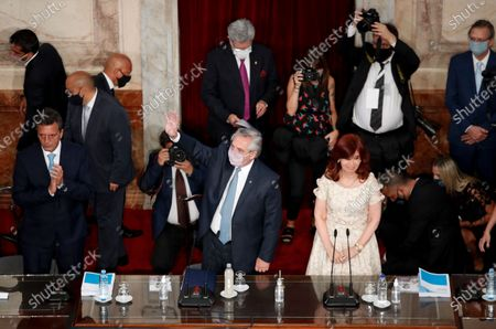 Argentine President Alberto Fernández waves as he arrives to deliver his State of the Nation address which marks the opening of the 2021 congressional session as Vice President Cristina Fernandez de Kirchner stands with him in Buenos Aires, Argentina