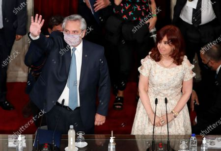 Argentine President Alberto Fernández waves as he arrives to deliver his State of the Nation address which marks the opening of the 2021 congressional session as Vice President Cristina Fernandez de Kirchner stands at his side in Buenos Aires, Argentina