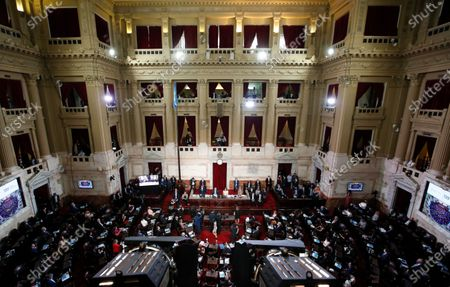 Lawmakers listen to Argentine President Alberto Fernández, sitting, center left, give his State of the Nation address which marks the opening of the 2021 congressional session, as Vice President Cristina Fernandez de Kirchner sits next to him in Buenos Aires, Argentina