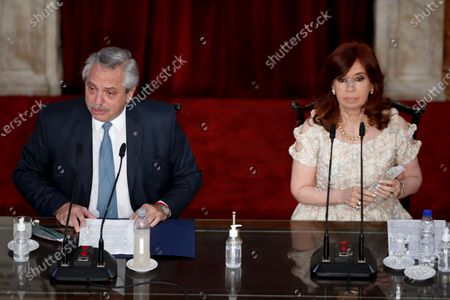 Argentina's President Alberto Fernández, left, delivers his annual State of the Nation address which marks the opening session of Congress, next to Vice President Cristina Fernandez de Kirchner in Buenos Aires, Argentina