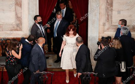 Argentina's President Alberto Fernández, center behind, and Vice President Cristina Fernandez de Kirchner, center front, arrive for the opening session of Congress, where the president will give his annual State of the Nation address in Buenos Aires, Argentina