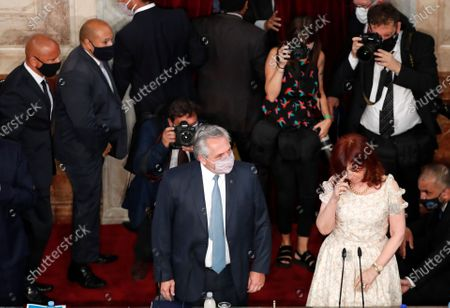 Argentine President Alberto Fernández, left, and Vice President Cristina Fernandez de Kirchner arrive for the opening session of Congress in Buenos Aires, Argentina