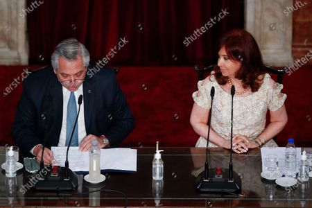 Argentina's President Alberto Fernández, left, delivers his State of the Nation speech that marks the opening session of Congress, next to Vice President Cristina Fernandez de Kirchner in Buenos Aires, Argentina