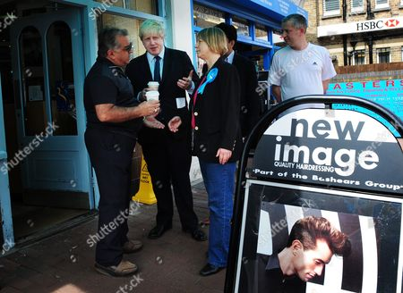 Mayor of London, Boris Johnson with  Angie Bray, Ealing Conservative Parliamentary candidate and local people outside New Image hairdressers