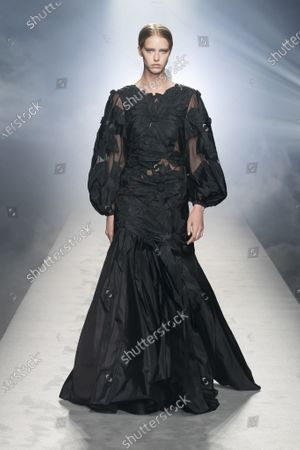 A Model wearing an outfit from the Womens Ready to wear, pret a porter, collections, winter  2021, original creation, during the Womenswear Fashion Week in Milan, from the house of Alberta Ferretti