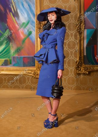 Liberty Ross wearing an outfit from the Womens Ready to wear, pret a porter, collections, winter 2021, original creation, during the Womenswear Fashion Week in Milan, from the house of Moschino