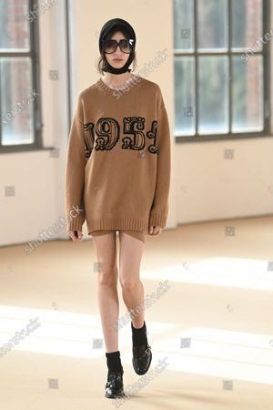 A Model wearing an outfit from the Womens Ready to wear, pret a porter, collections, winter  2021, original creation, during the Womenswear Fashion Week in Milan, from the house of Max Mara