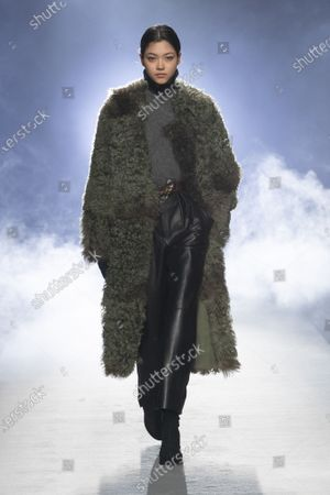Stock Photo of A Model wearing an outfit from the Womens Ready to wear, pret a porter, collections, winter  2021, original creation, during the Womenswear Fashion Week in Milan, from the house of Alberta Ferretti
