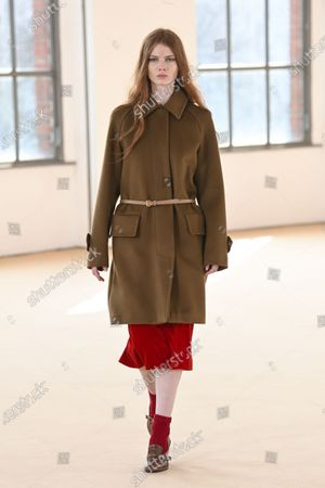 Stock Photo of A Model wearing an outfit from the Womens Ready to wear, pret a porter, collections, winter  2021, original creation, during the Womenswear Fashion Week in Milan, from the house of Max Mara