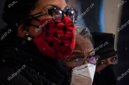 Malcolm X daughters Ilyasah Shabazz, left, Qubiliah Shabazz, center, and Gamilah Shabazz, right, listen as a letter, believed to be a confession from former NYPD officer Ray Wood, is revealed during a press conference, at the Malcolm X and Dr. Betty Shabazz center in New York. Wood, an undercover NYPD officer in the 1960s, confessed in a deathbed declaration letter that he conspired with NYPD and the FBI to undermine the legitimacy of Malcolm X and other leaders of the civil rights movement