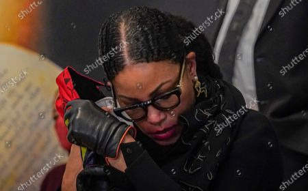 Stock Picture of Malcolm X daughter Ilyasah Shabazz adjusts her mask during a press conference, where a letter believed to be a confession from former NYPD officer Ray Wood was revealed, at the Malcolm X and Dr. Betty Shabazz center in New York. Wood, an undercover NYPD officer in the 1960s, confessed in a deathbed declaration letter that he conspired with NYPD and the FBI to undermine the legitimacy of Malcolm X and other leaders of the civil rights movement