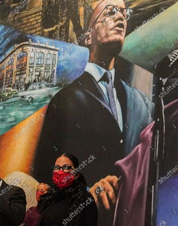 Malcolm X daughter Ilyasah Shabazz sits next to a mural of her father during a press conference, where a letter believed to be a confession from former NYPD officer Ray Wood was revealed, at the Malcolm X and Dr. Betty Shabazz center in New York. Wood, an undercover NYPD officer in the 1960s, confessed in a deathbed declaration letter that he conspired with NYPD and the FBI to undermine the legitimacy of Malcolm X and other leaders of the civil rights movement