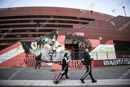 A mural in pixel art displays the kiss between two women in the sunlight by street artist Krayon, in collaboration of the agency Zon Productions and the City Hall III of Rome Capital, prior its inaugurated at the Metro B Jonio in Rome, Italy, 01 March 2021. The work shows the toll-free number 800.713.713, contact center against homotransphobia that every year, as reported in the press release, receives about 20,000 contacts, offering listening and support to victims. Together with the Italian Red Cross, the Gay Center also manages the reception of young victims of violence with the Refuge LGBT family home.