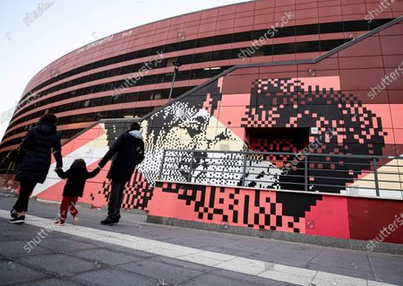 Stock Image of A mural in pixel art displays the kiss between two women in the sunlight by street artist Krayon, in collaboration of the agency Zon Productions and the City Hall III of Rome Capital, prior its inaugurated at the Metro B Jonio in Rome, Italy, 01 March 2021. The work shows the toll-free number 800.713.713, contact center against homotransphobia that every year, as reported in the press release, receives about 20,000 contacts, offering listening and support to victims. Together with the Italian Red Cross, the Gay Center also manages the reception of young victims of violence with the Refuge LGBT family home.