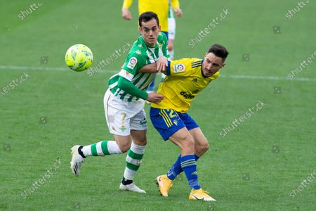 "Juan Miguel Angel Jimenez of Real Betis and Isaac ""Iza"" Carcelen of Cadiz"