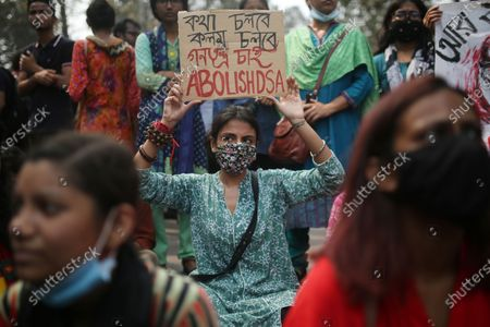 Activists from the left parties hold placards as they shout slogans in a protest march during a demonstration in Dhaka, Bangladesh on March 01, 2021, following the death of a Bangladeshi writer Mustak Ahmed in prison, who was arrested under the digital security act.