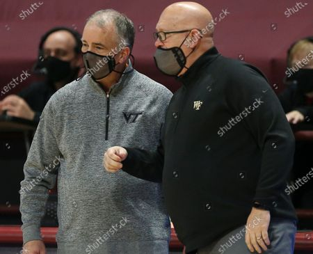 Virginia Tech head coach Mike Young, left, talks with Wake Forest head coach Steve Forbes at the start of an NCAA college basketball game in Blacksburg, Va