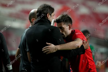 Pizzi of SL Benfica (R ) celebrates with Rui Costa after scoring a goal during the Portuguese League football match between SL Benfica and Rio Ave FC at the Luz stadium in Lisbon, Portugal on March 1, 2021.