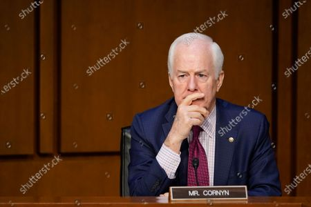 Sen. John Cornyn, R-Texas, attends a Senate Judiciary Committee meeting on Capitol Hill in Washington, . The Senate Judiciary Committee voted Monday to advance the nomination of Merrick Garland, President Joe Biden's nominee for attorney general