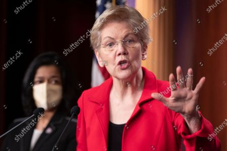 Democratic Senator from Massachusetts Elizabeth Warren participates in a news conference with Democratic Representative from Washington Pramila Jayapal (Back), to introduce the 'Ultra-Millionaire Tax Act', on Capitol Hill in Washington, DC, USA, 01 March 2021. The measure would hike the taxes of the extremely wealthy in an attempt to create revenue to offset income disparities and lost federal funds due to the coronavirus COVID-19 pandemic.