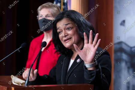 Democratic Representative from Washington Pramila Jayapal participates in a news conference with Democratic Senator from Massachusetts Elizabeth Warren (Back), to introduce the 'Ultra-Millionaire Tax Act', on Capitol Hill in Washington, DC, USA, 01 March 2021. The measure would hike the taxes of the extremely wealthy in an attempt to create revenue to offset income disparities and lost federal funds due to the coronavirus COVID-19 pandemic.