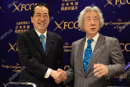 Former Japanese Prime Ministers Junichiro Koizumi (R) and Naoto Kan (L) shake their hands as they hold a press conference at the Foreign Correspondents' Club of Japan in Tokyo on Monday, March 1, 2021. Koizumi and Kan urged Japanese government to quit nuclear power plant ten years after TEPCO's Fukushima nuclear plant was crippled by tsunami and earthquake.
