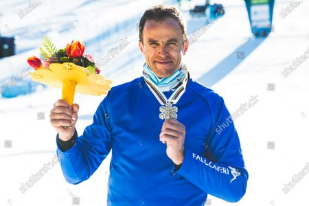 Stock Photo of Roland Fischnaller (ITA) during parallel giant slalom at FIS Snowboard Alpine World Championships 2021