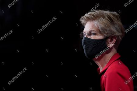 Sen. Elizabeth Warren, D-Mass., listens during a news conference on Capitol Hill in Washington, to unveil a proposed Ultra-Millionaire Tax Act