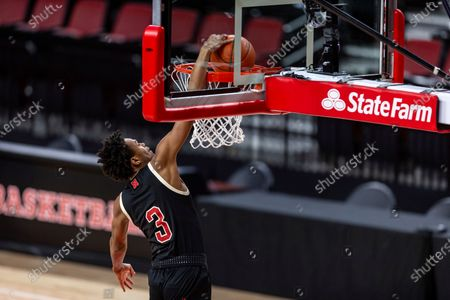Nebraska guard Elijah Wood (3) makes a dunk against Rutgers in the second half during an NCAA college basketball game, in Lincoln, Neb