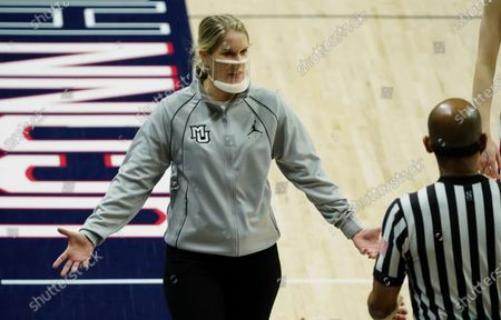 Stock Image of Marquette head coach Megan Duffy reacts on the sideline in the first half against Connecticut in an NCAA college basketball game, in Storrs, Conn