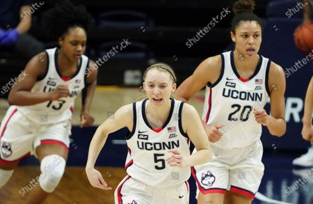 Stock Image of Connecticut guard Christyn Williams (13) and guard Paige Bueckers (5) and forward Olivia Nelson-Ododa (20) return upcourt in the second quarter against Marquette during an NCAA college basketball game, in Storrs, Conn
